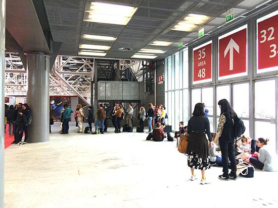 Illustrators queue for publisher. Photograph by Jean Mackey Lebleu