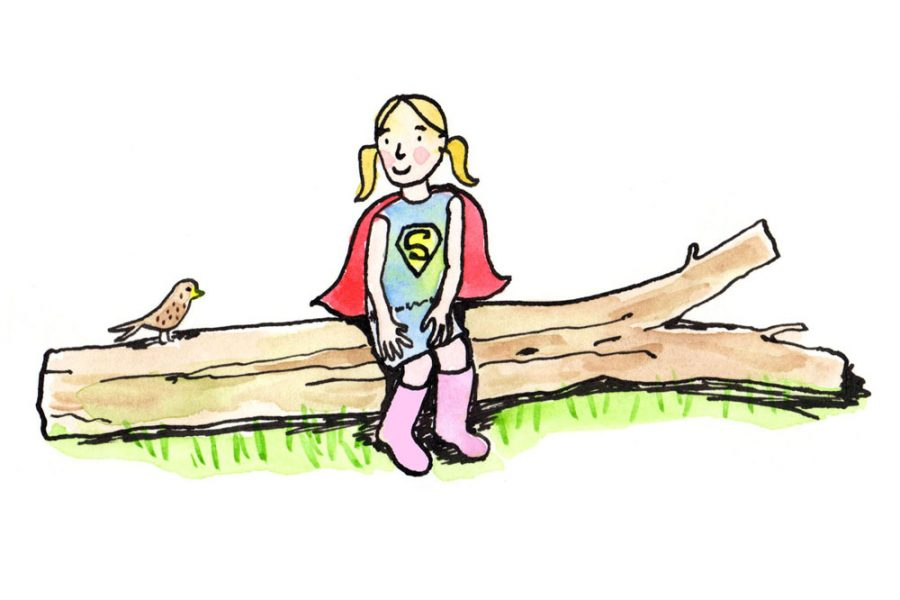 Child sitting on a log