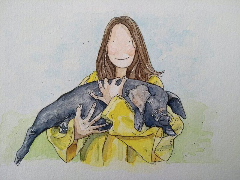 Girl Cuddling a Pig