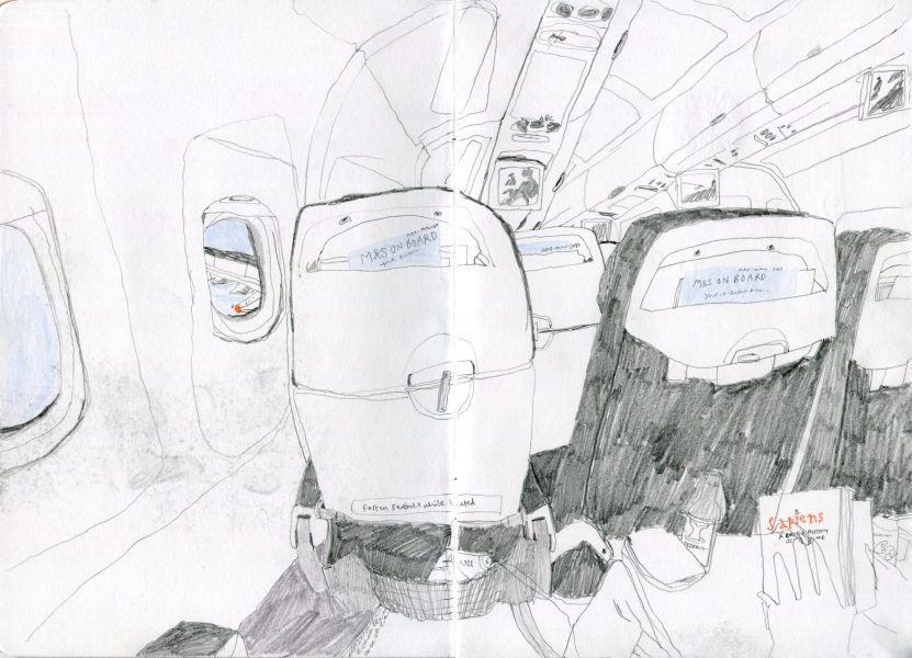 sketchbook seats on a plane to germany